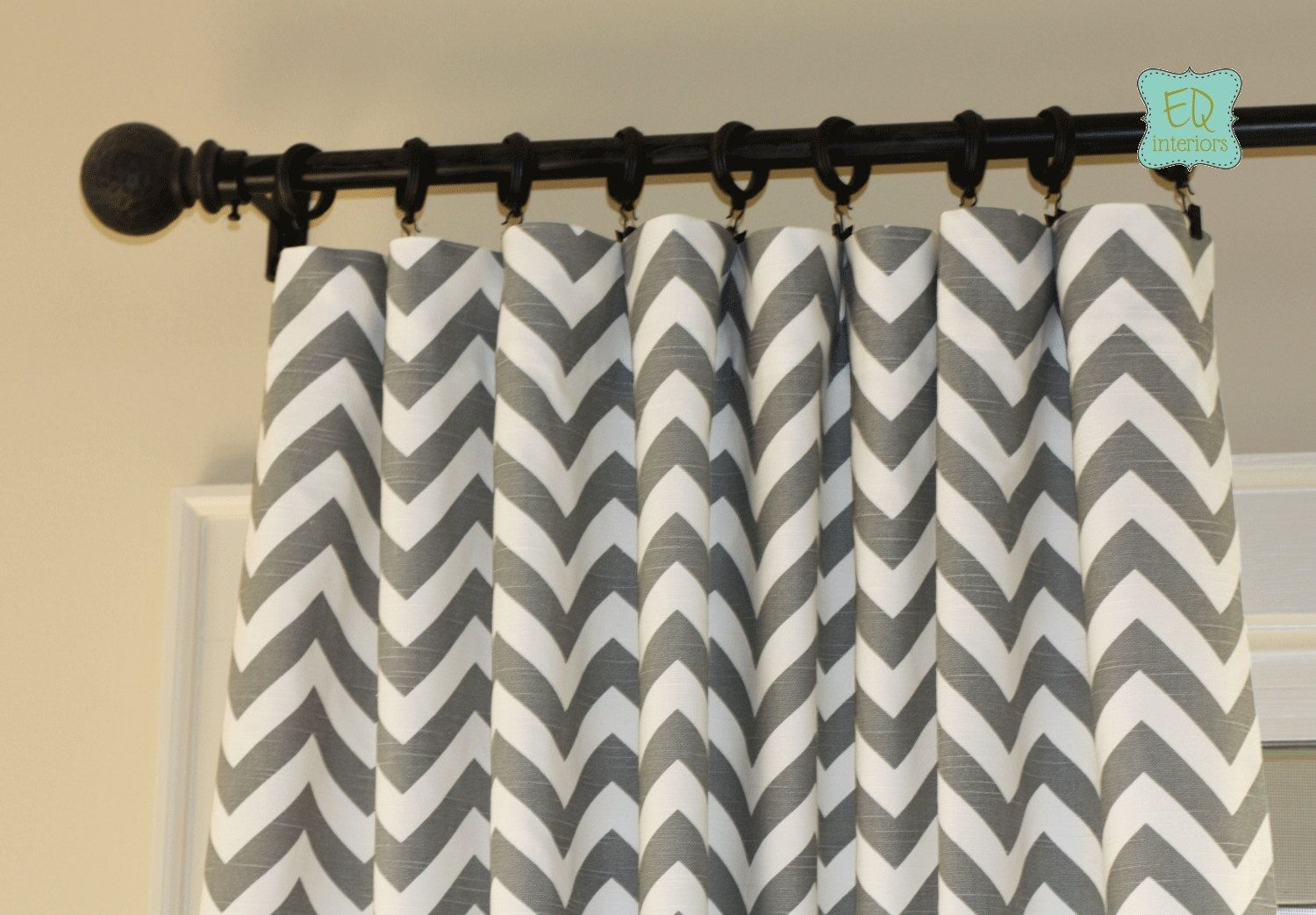white And Gray Chevron Curtains with black finial matched with wheat wall