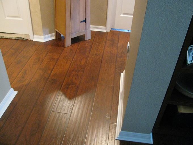White Baseboard Molding With Tan Wall And Wooden Floor Looks Awesome