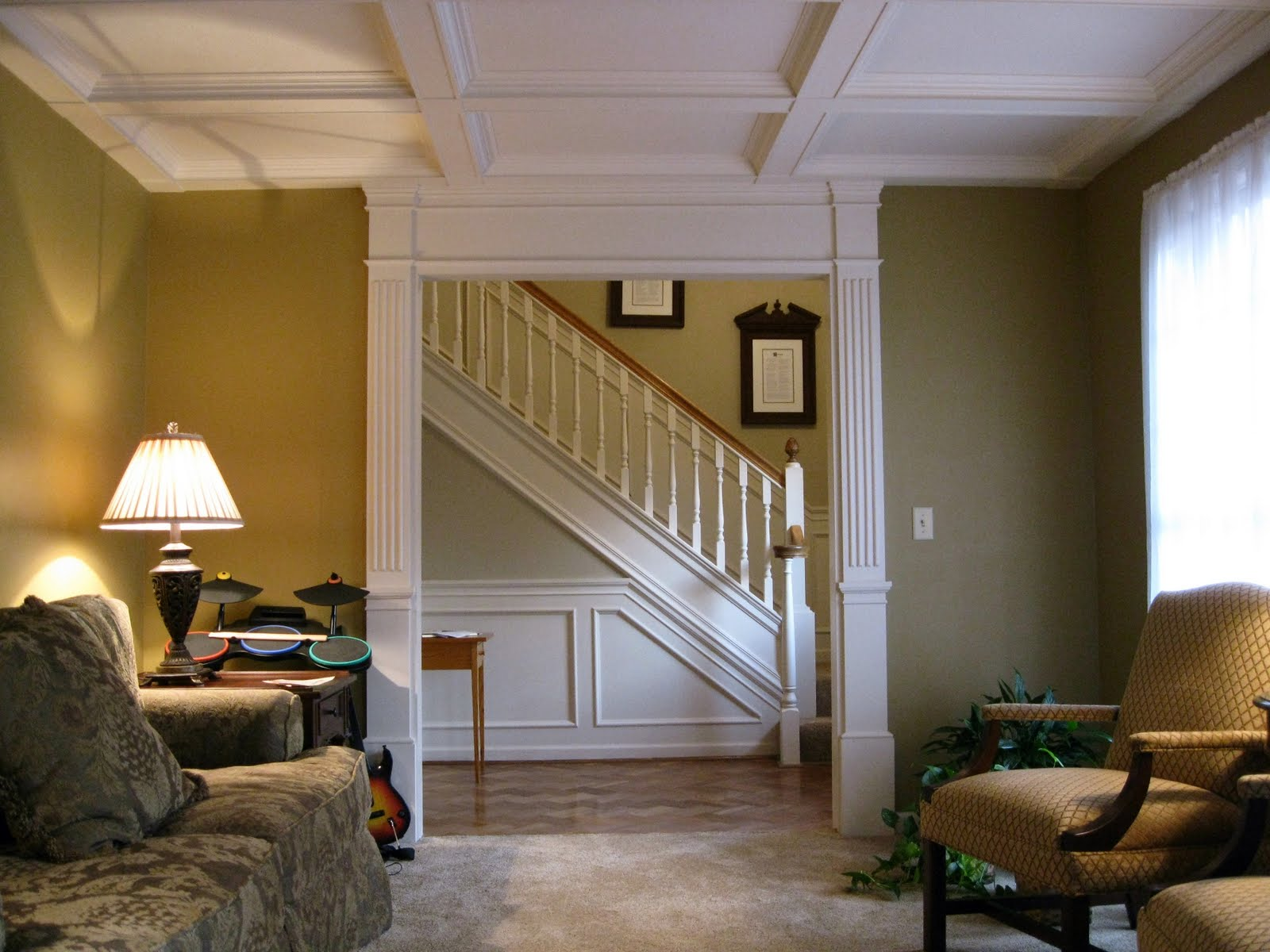 white coffered ceiling matched with olive wall plus sofa and table standing lamp