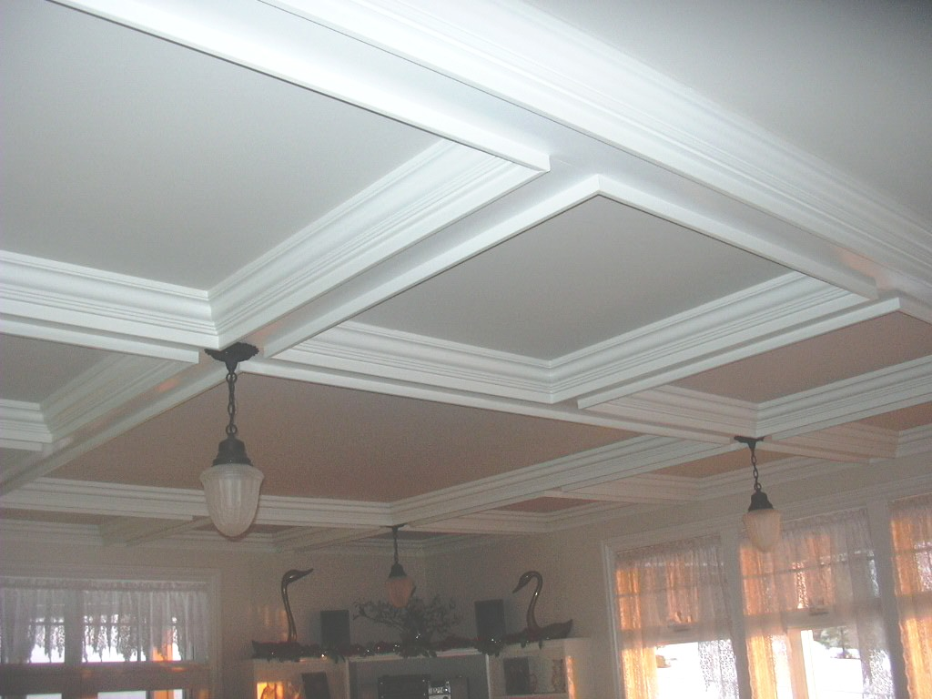 white coffered ceiling with chandelier mathed with white wall plus window and curtains