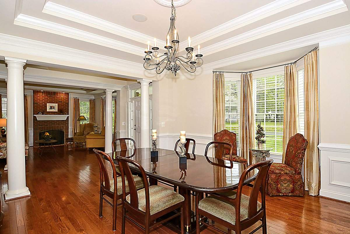 white coffered ceiling with chandelier with dining table and wooden floor for dining decot ideas