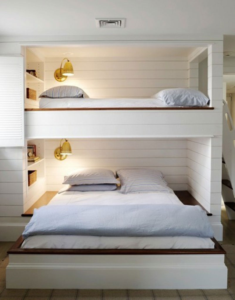 white double loft beds for teens with chandelier and books area
