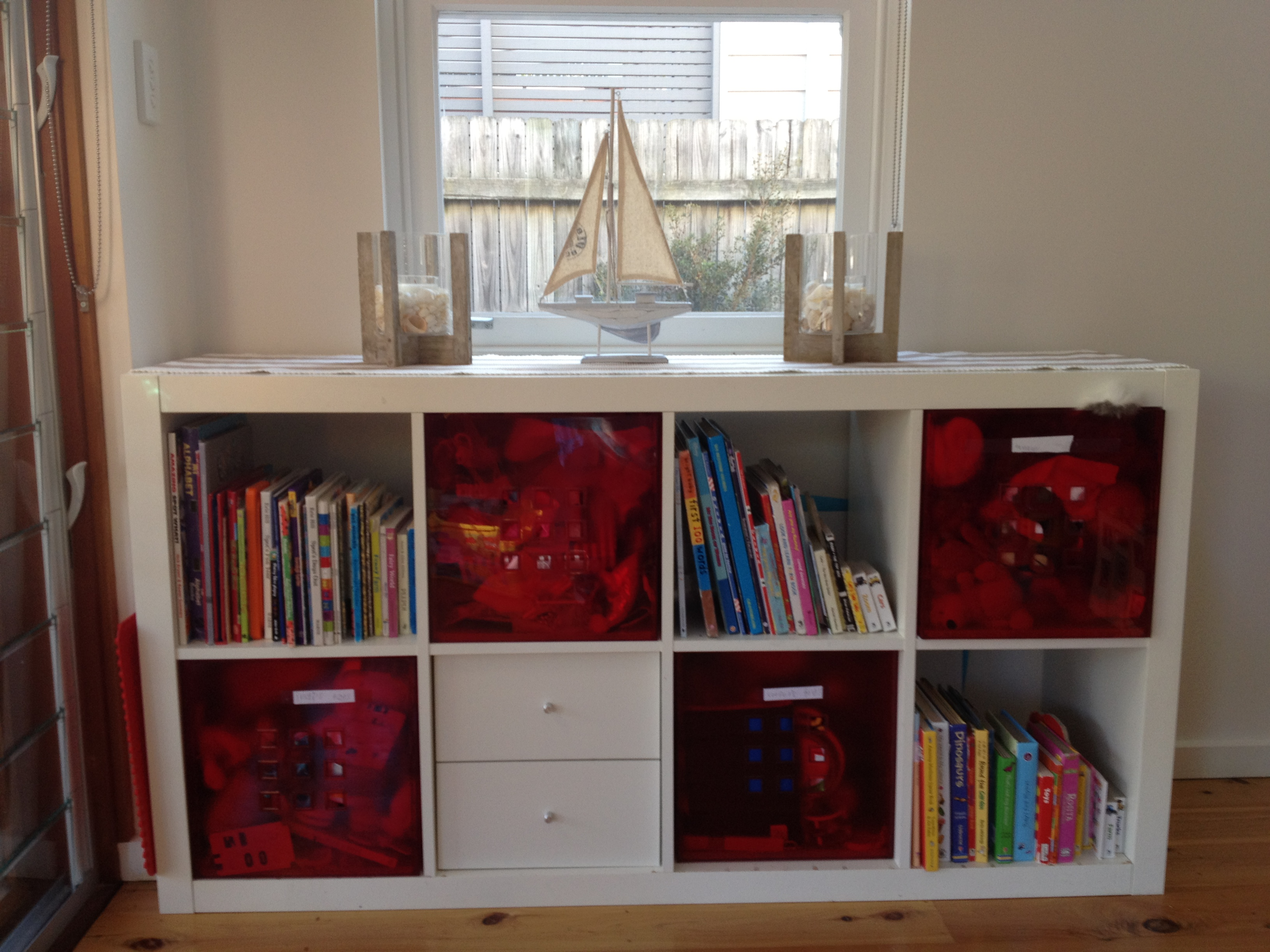 Make A Pretty Kids Room With Smart Ikea Toy Storage Ideas: White Ikea Toy Storage Filled With Books And Other Goods Near Window With Wooden Floor And White Wall