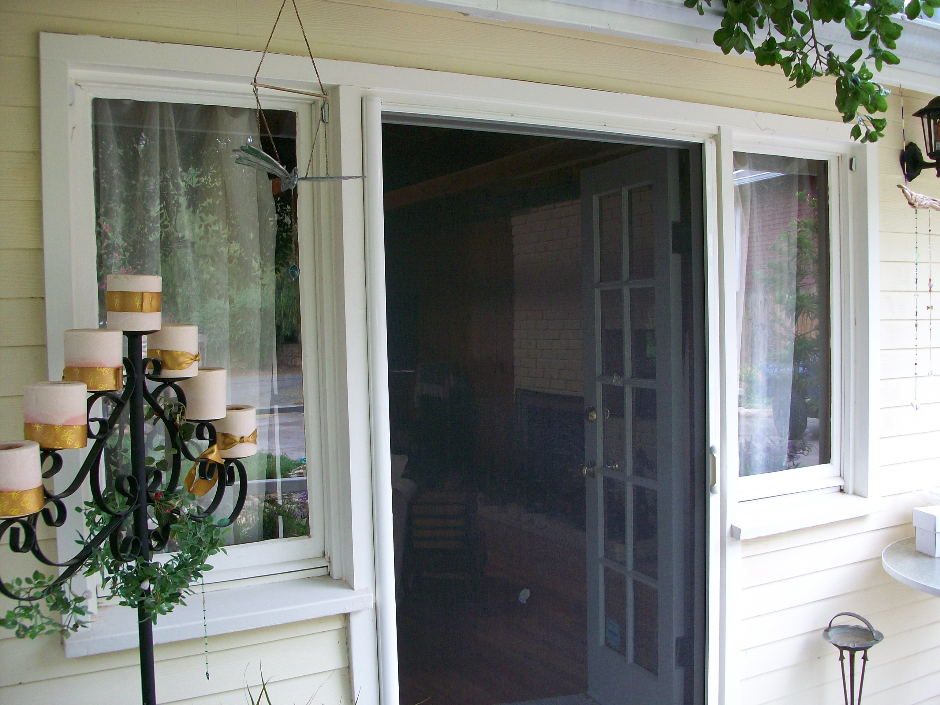 white Retractable screen doors with cream wall and double windows