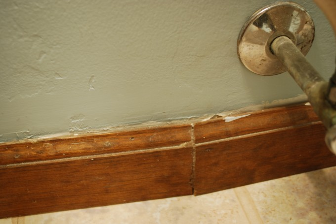 Wooden Baseboard Molding With Ceramics Floor And Grey Wall