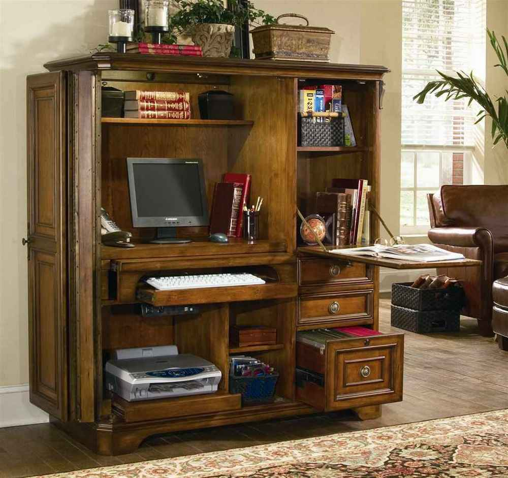 wooden computer armoire with computer and floral carpet and wooden floor for your home office decor ideas