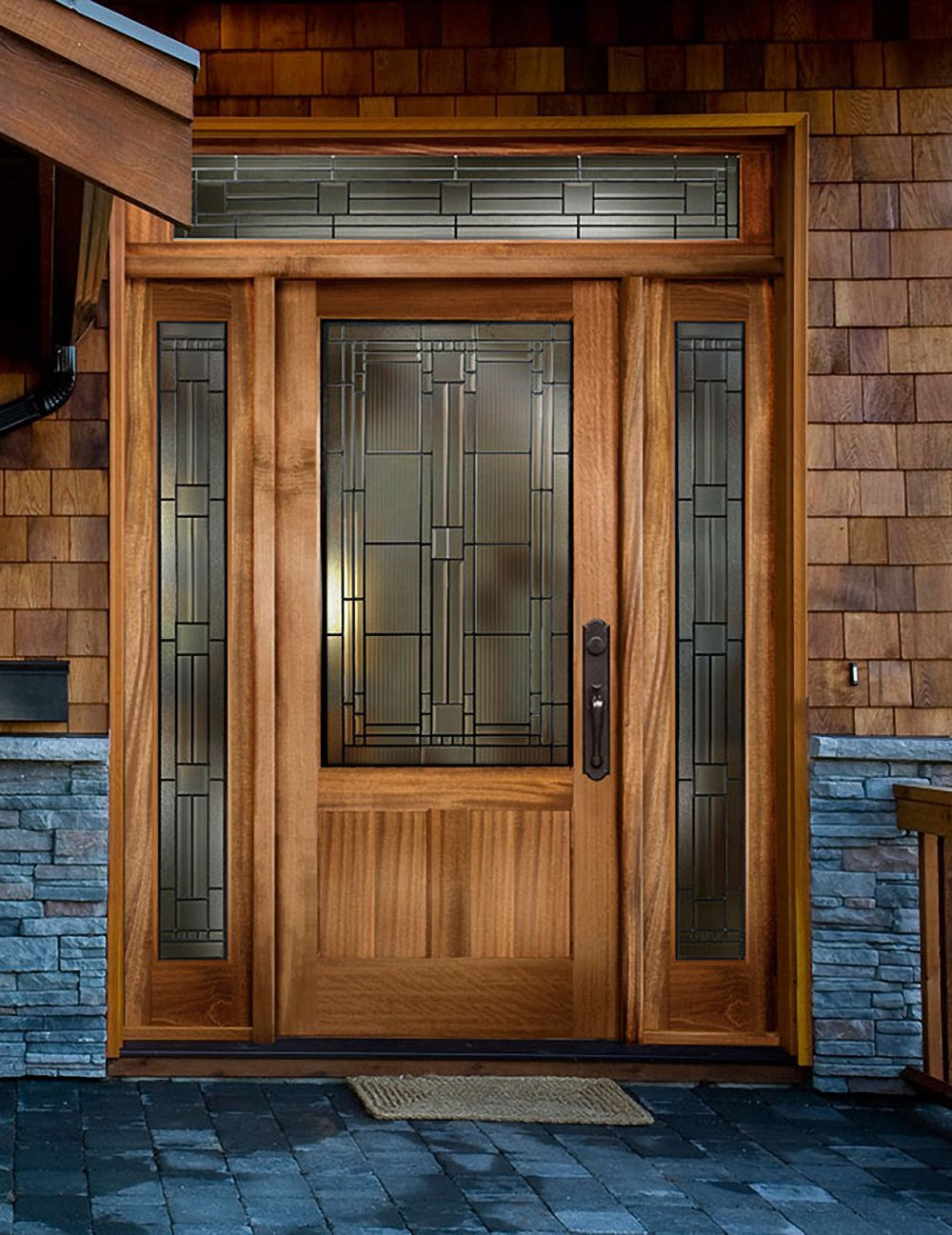 wooden entry door with sidelights with brown handle and brick touching on wall