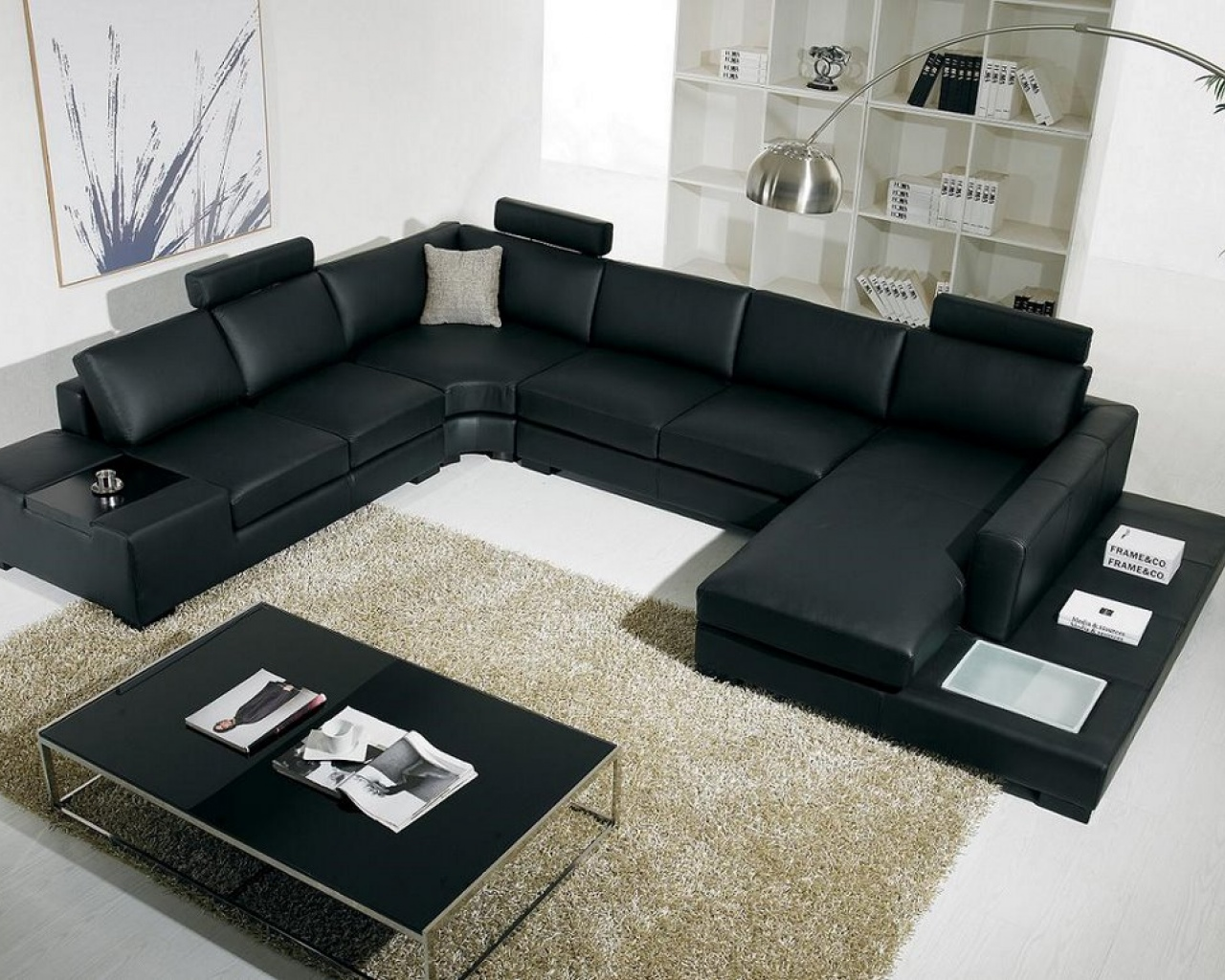 amazing and elegant black Sectional Couches on white ceramic floor plus cream carpet plus glass table for inspiring family room decor ideas