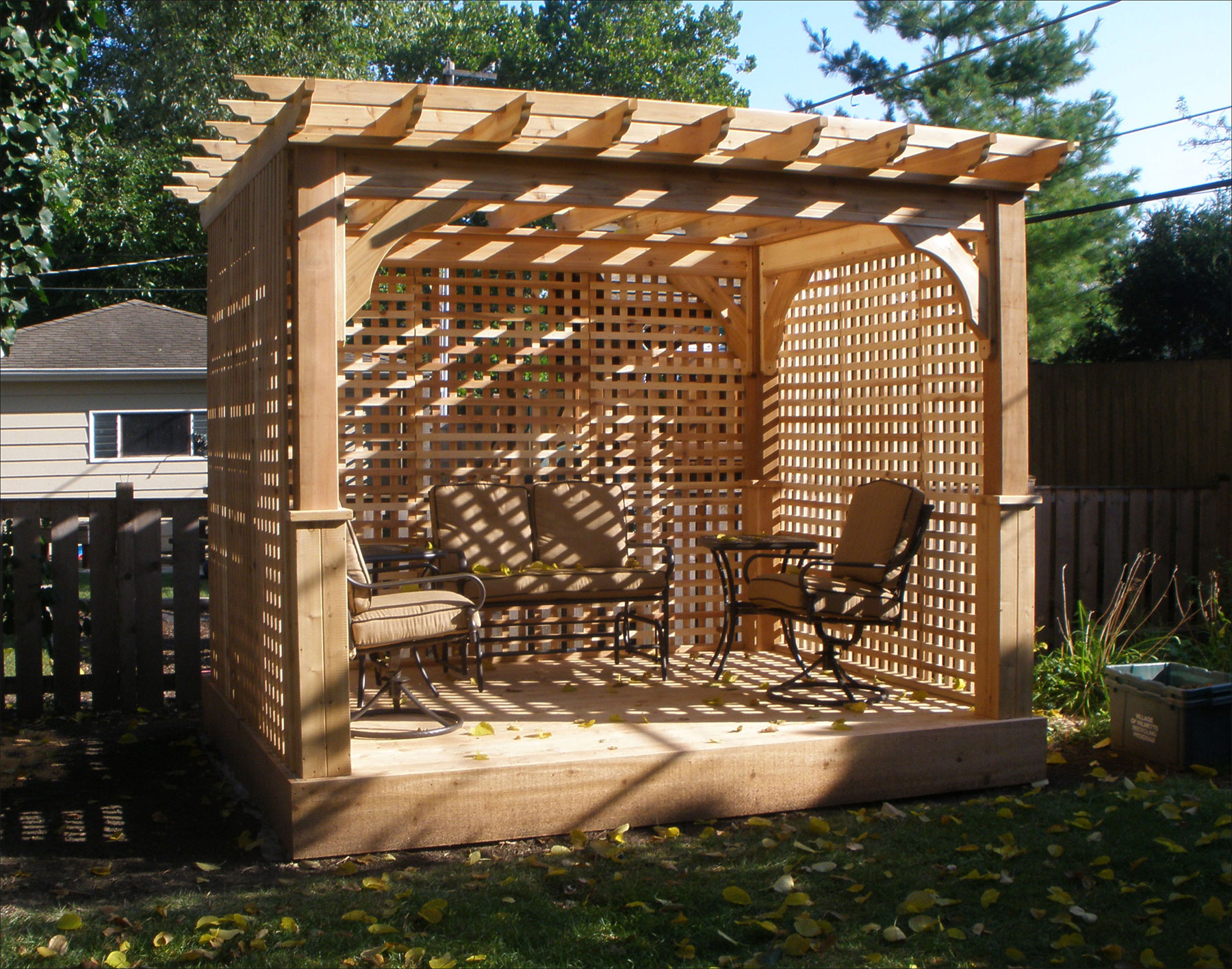 amazing wooden Pergola plans with triple closed side Ideas for Backyard with brown chairs
