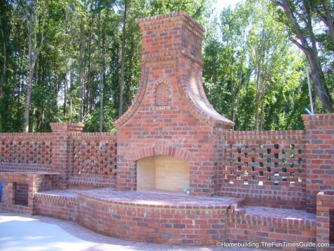 An Outdoor Isokern Fireplace With Brick Wall Ideas