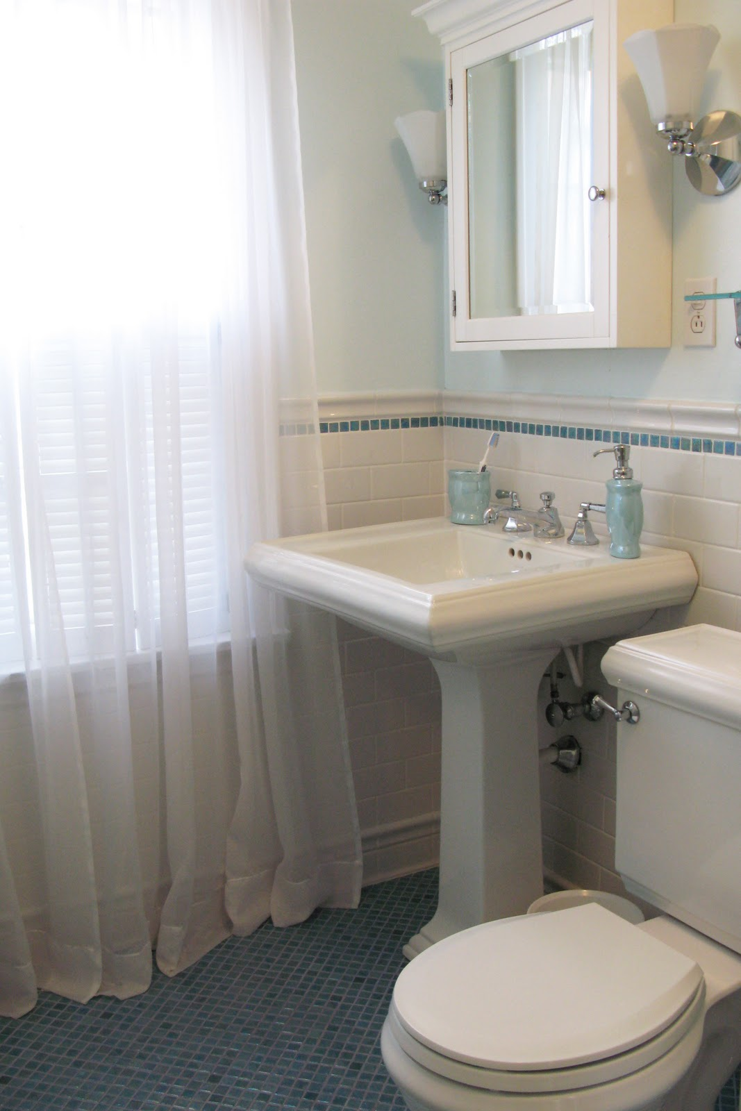 Astonishing bathroom with White kohler sinks with faucet plus mirror and white curtains ideas