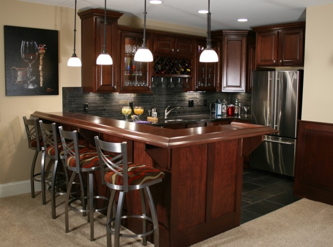 Astounding Brown Aristokraft Cabinets With Black Back Splash Plus Oven And Frige And Bar Table For Kitchen Decor Ideas