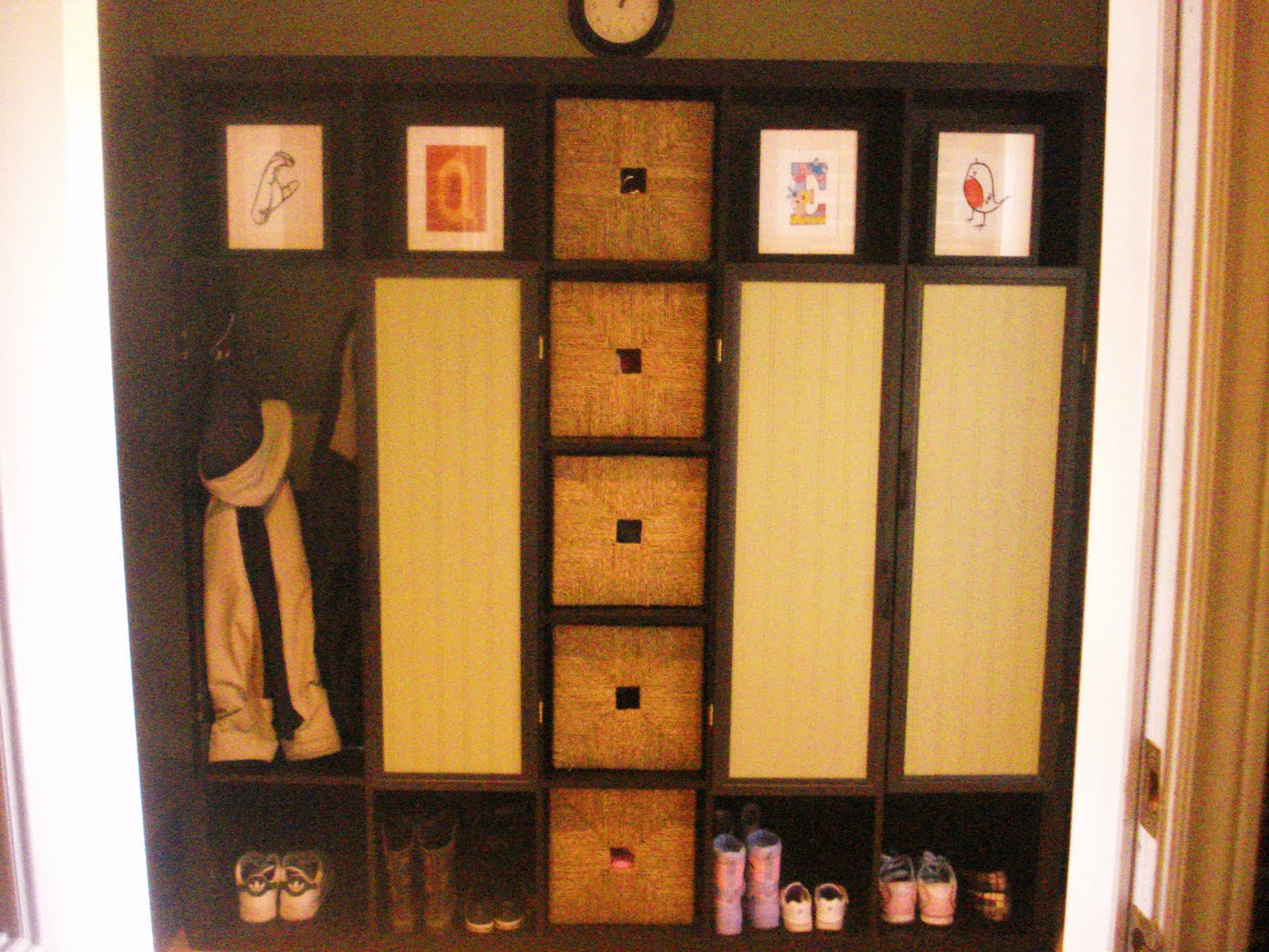 awesome ikea expedit bookcase filled with frames and shoes with storage