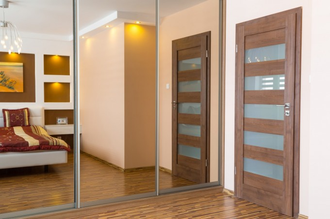 Awesome Trustile Doors With Mirror And Cream Wall Plus Wooden Floor Ideas
