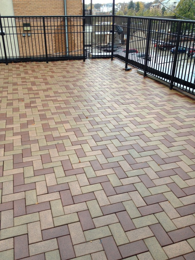 AZEK Pavers Matched With Black Railing For Exterior Design Ideas