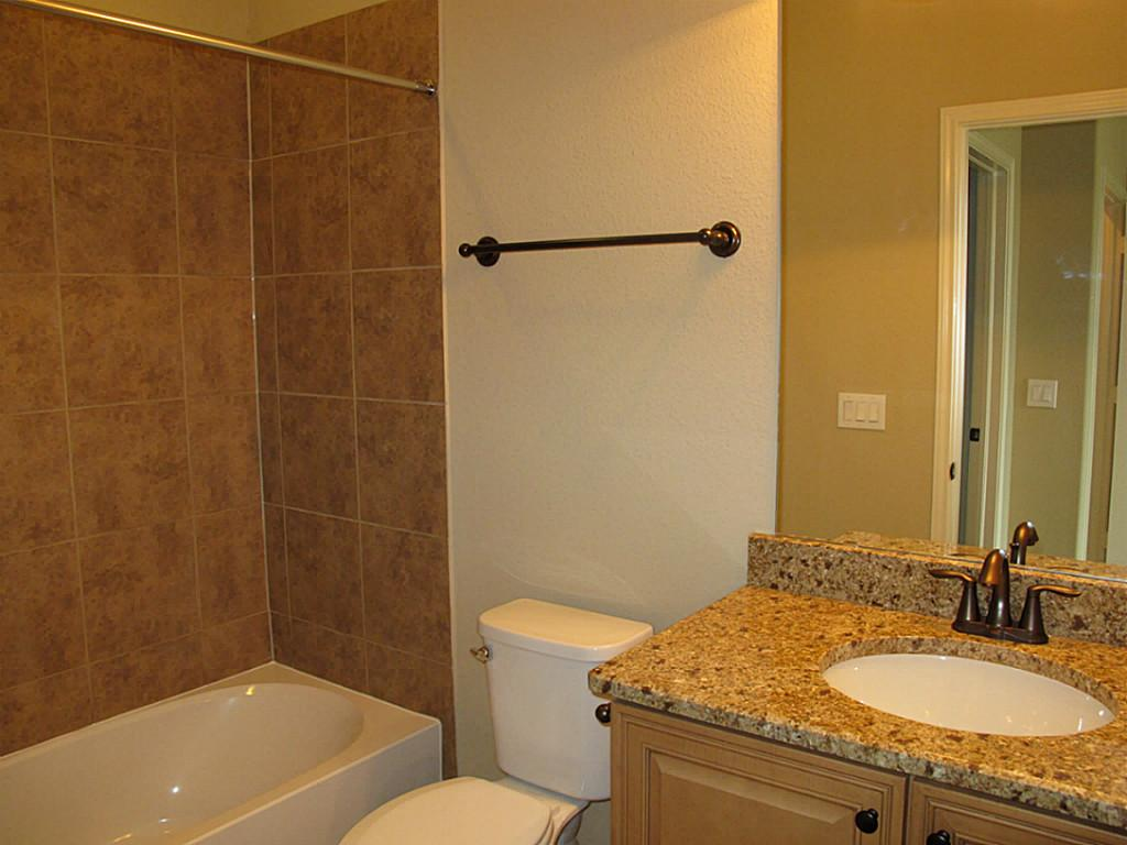 bathroom with emser tile wall plus white bath up and sink plus mirror ideas