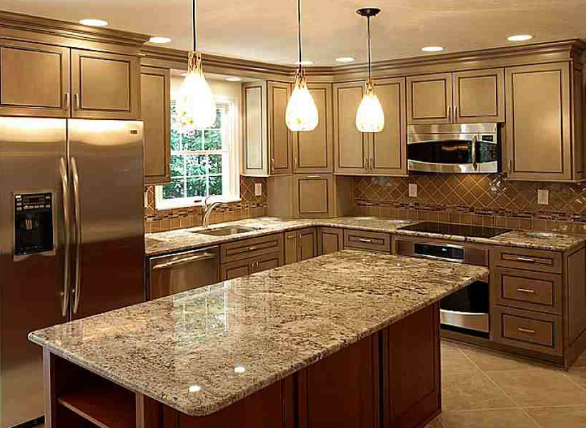 Beautiful cream Aristokraft Cabinets With mosaic tile back splash and marble countertop plus oven and frige for kitchen decor inspiration