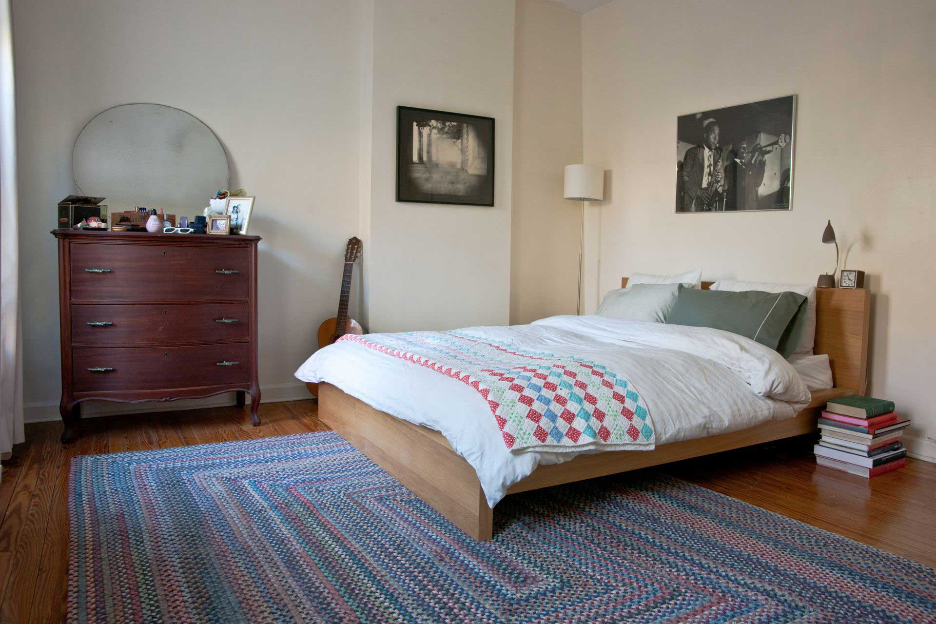 beautiful room decor with big rectangle multicolor braided rugs plus white bedding on wooden floor ideas