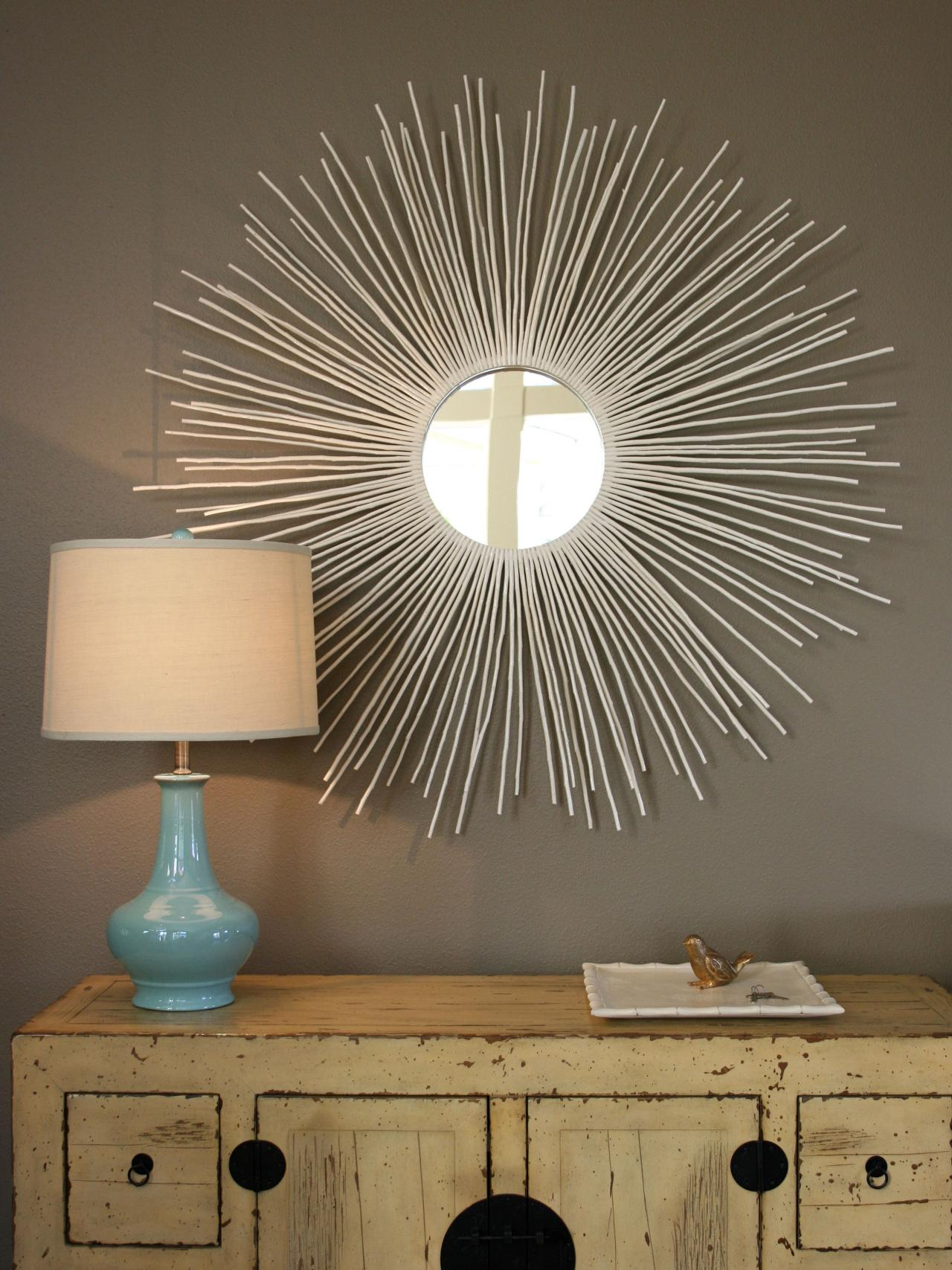 beautiful starburst wall decor with mirror on grey wall plus wooden table plus table lamp ideas
