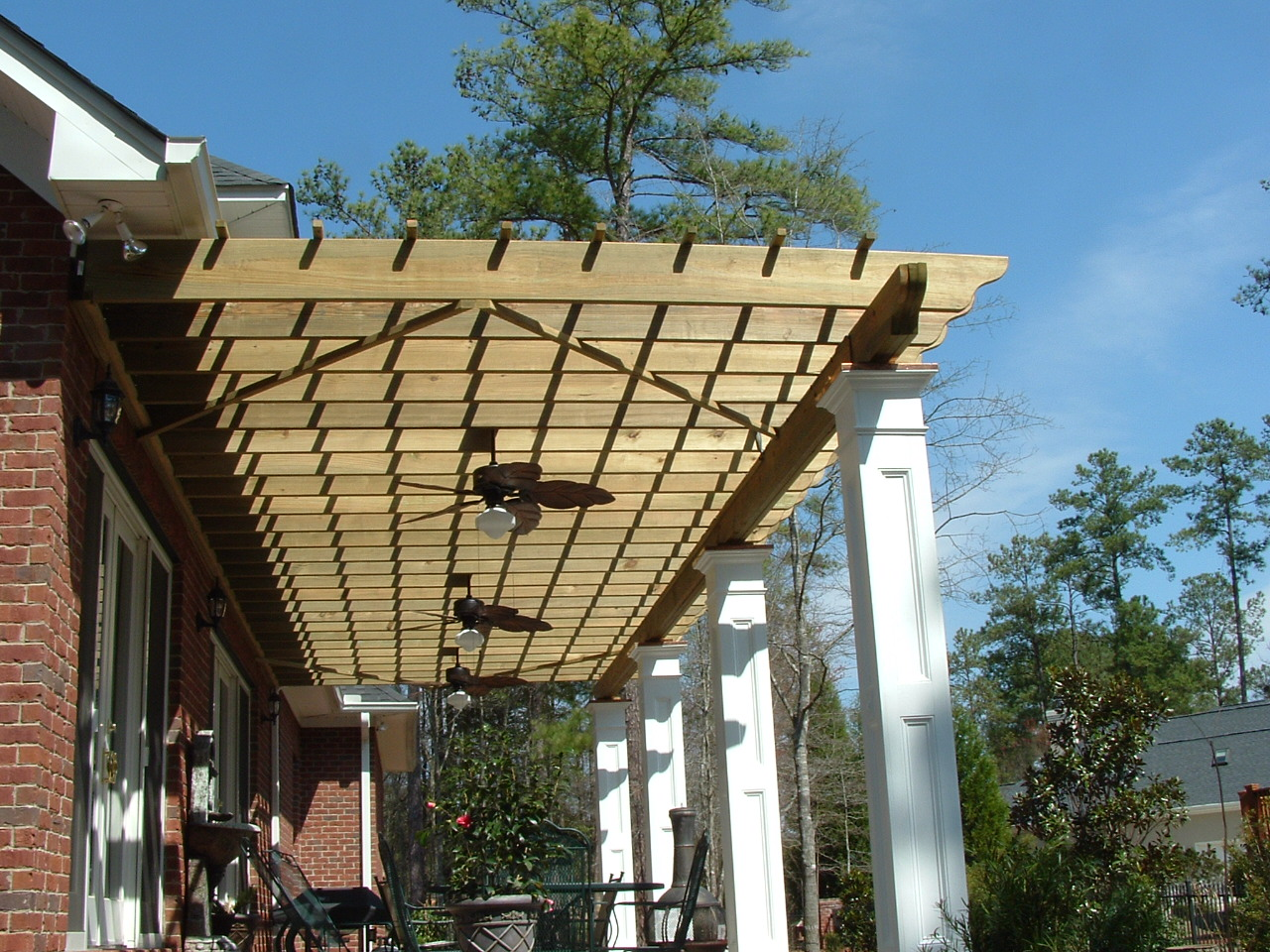 Best Pergola plans with white prop plus ceiling fans and chairs