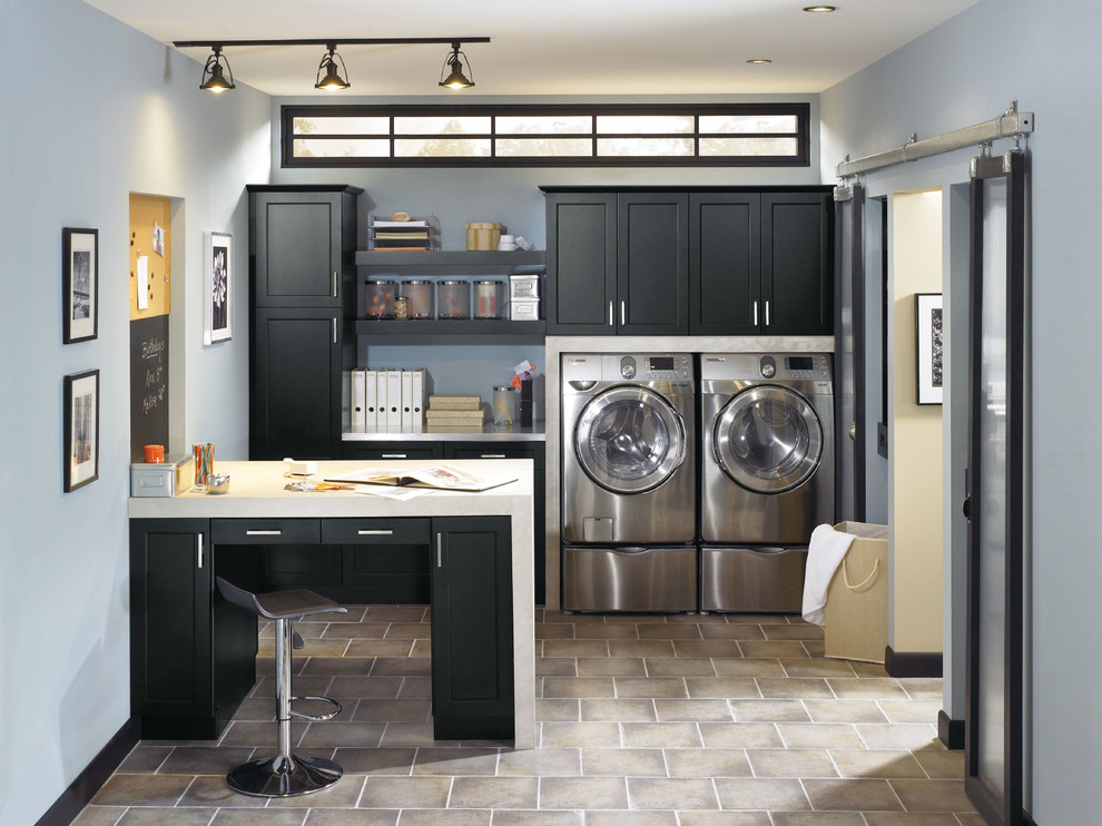 black aristokraft cabinets with silver handle and washer matched with blue wall for laundry room ideas
