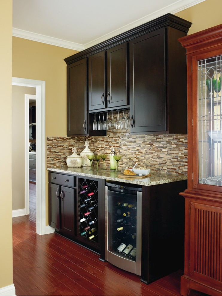 black Aristokraft Cabinets With tile back splash plus wooden floor for kitchen ideas