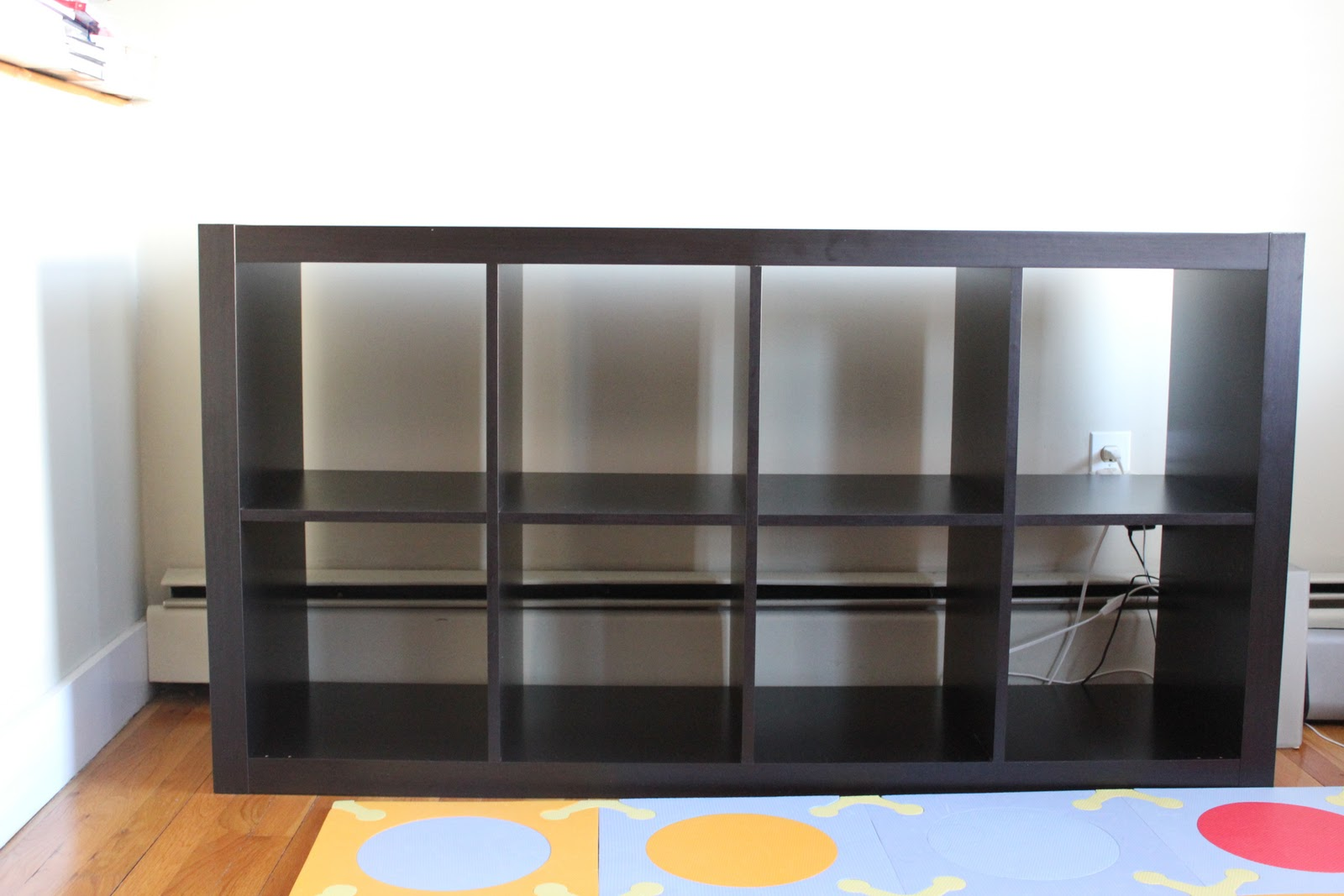 black ikea Expedit Bookcase before white wall ideas with wooden floor plus multicolor carpet