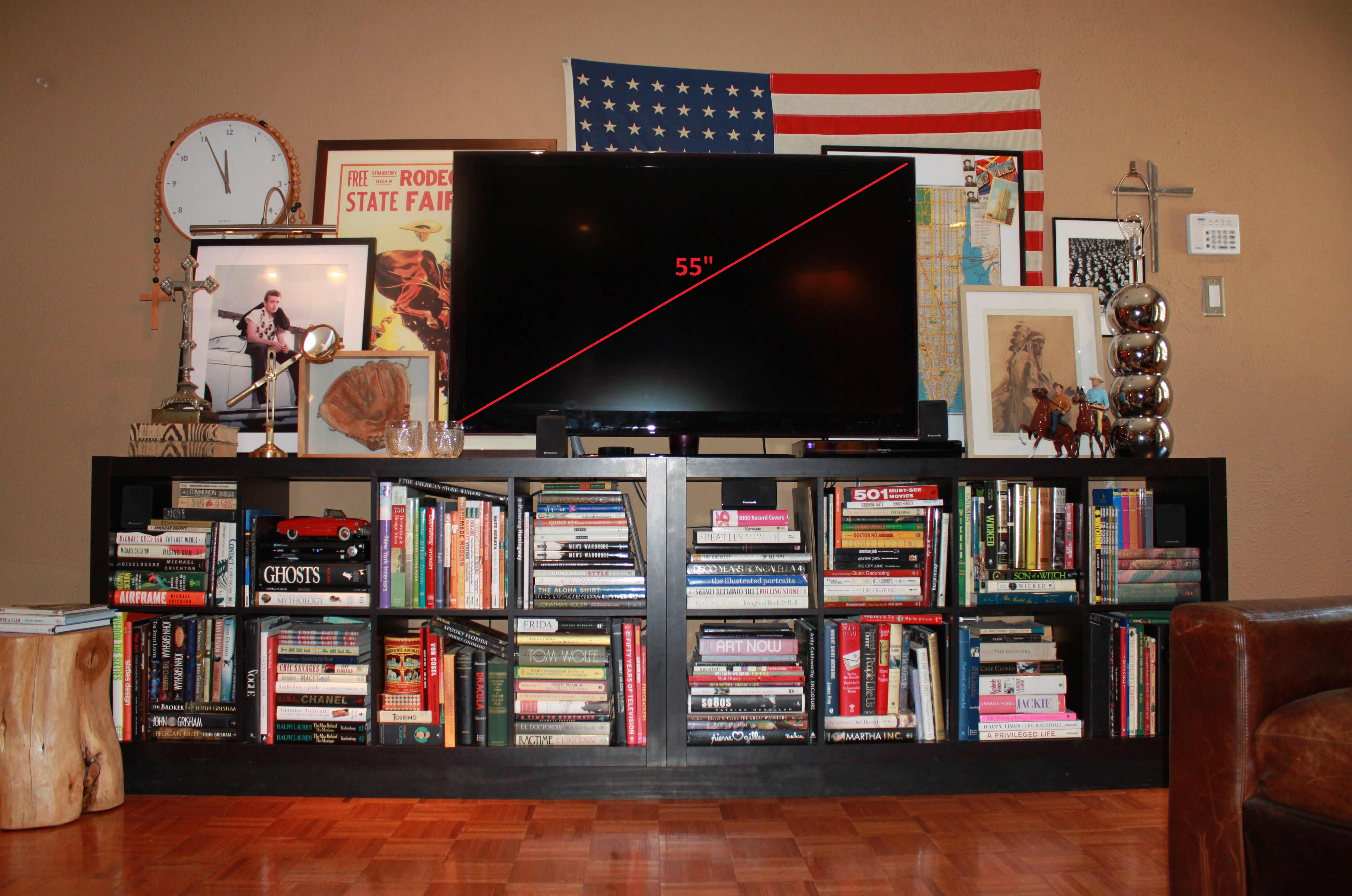 black Ikea Expedit Bookcase filled with book plus tv above ideas with american flag and tan wall plus brown floor