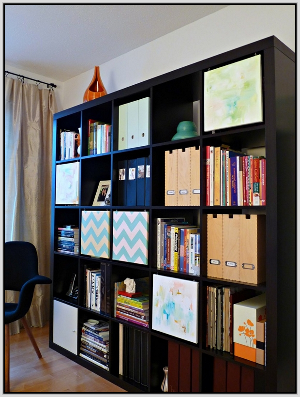 black ikea expedit bookcase filled with books and files ideas with blue chairs and cream curtains