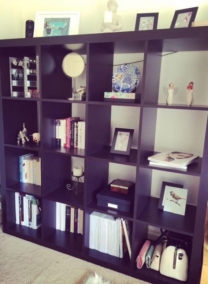 Black Ikea Expedit Bookcase Filled With Books And Frame Plus Other Things