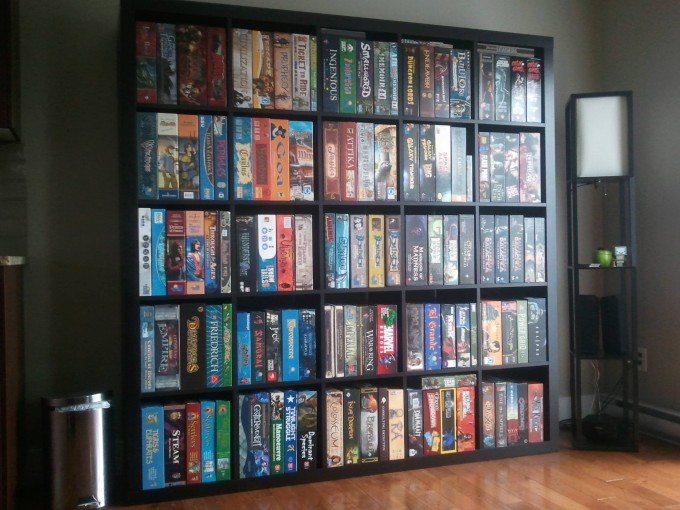 Black Ikea Expedit Bookcase Filled With Movies Files On Wooden Floor With White Wall