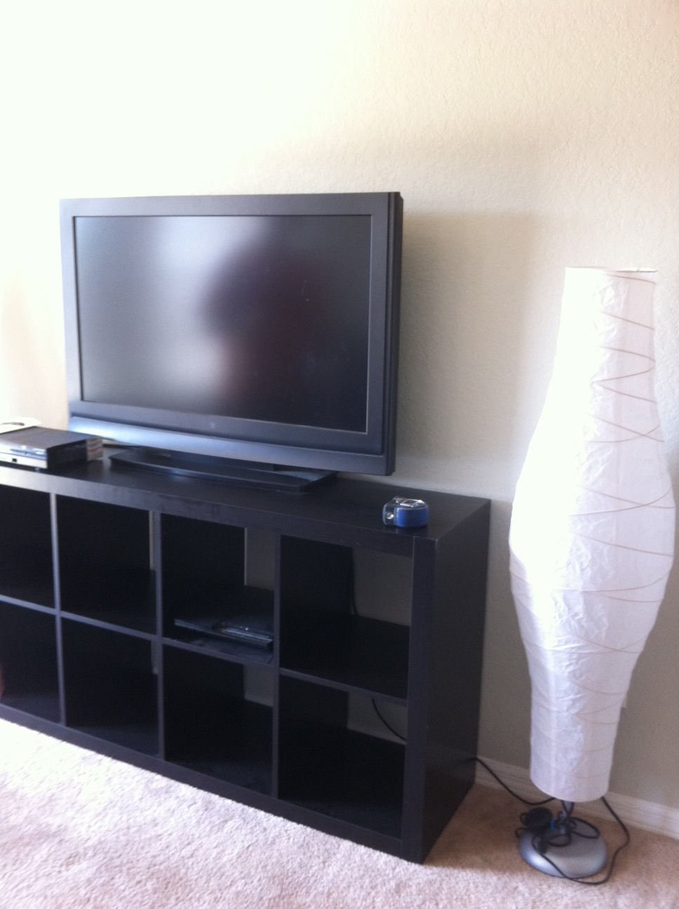 black IKEA Expedit bookcase with tv stand ideas with white wall and white jar