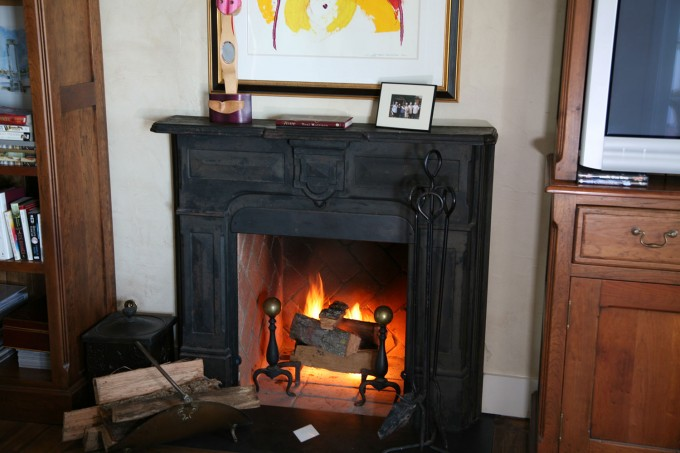 Black Isokern Fireplace On The White Wall With Picture For Heatwarming Room Decor Ideas