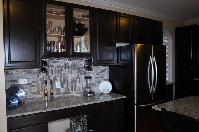 Black Kitchen Cabinet Refacing With Marble Countertop Plus Black Frige