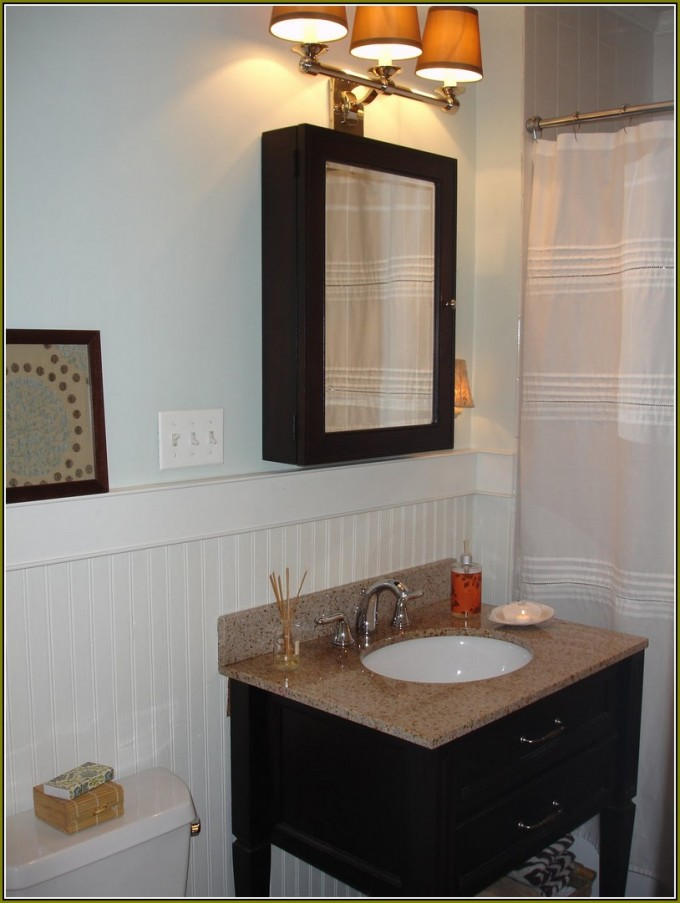Black Lowes Medicine Cabinets With Mirror On Bathroom With White Wall And White Curtains Plus Sink With Faucet