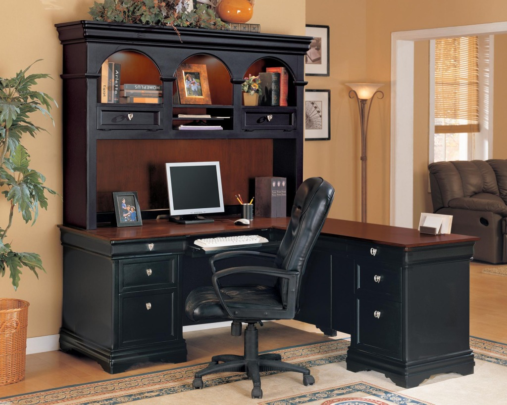 Black Office l shaped Desk with hutch plus computer and white chair on peachpuff floor plus carpet for home office ideas