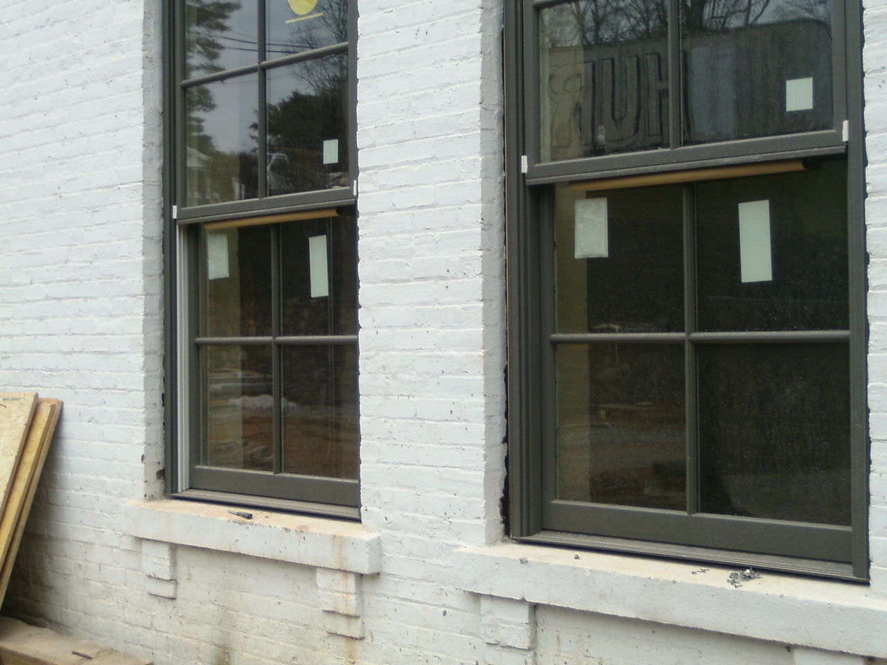black pella windows matched with white bricked wall ideas
