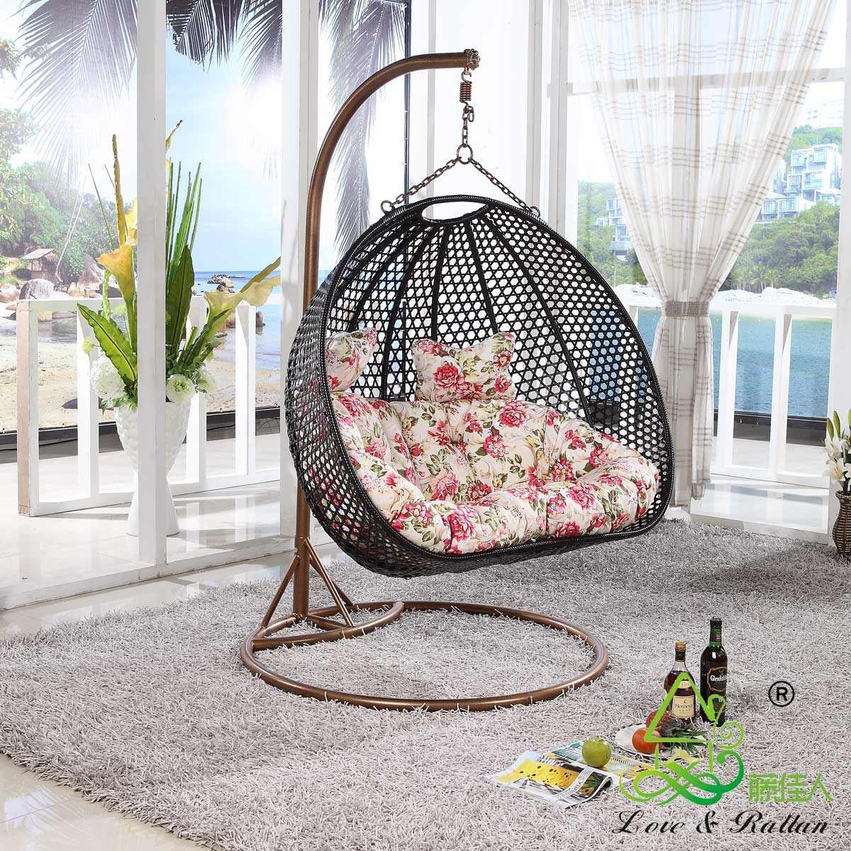black rattan swingasan chair with floral seat cushion and brown metal stand ideas