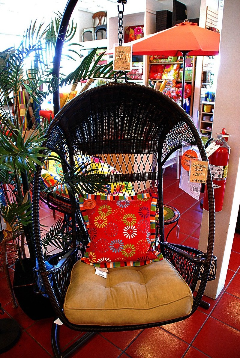 black swingasan chair with red floral and cream cushions ideas