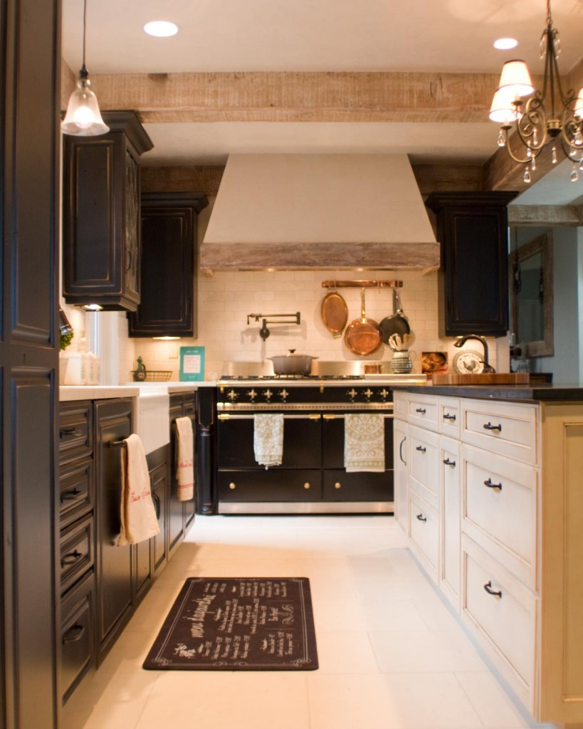 black Thomasville Cabinets with white countertop and oven plus chimney on white flooring for kitchen decor ideas