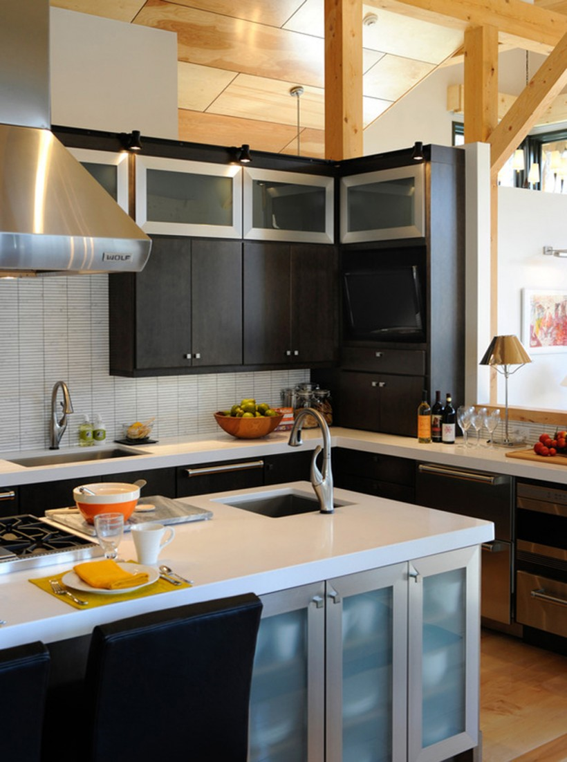 black Thomasville Cabinets with white countertop and sink plus oven and chimney for kitchen decor ideas