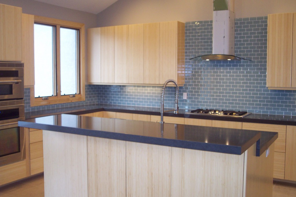 blue Caesarstone countertop with sink and faucet plus oven and chimney for kitchen decor ideas