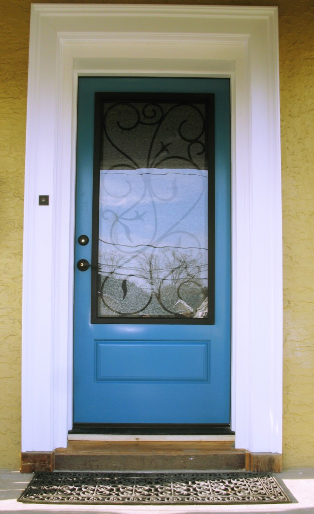 blue therma tru entry doors with black handle matched with door wainscot and cream wall ideas