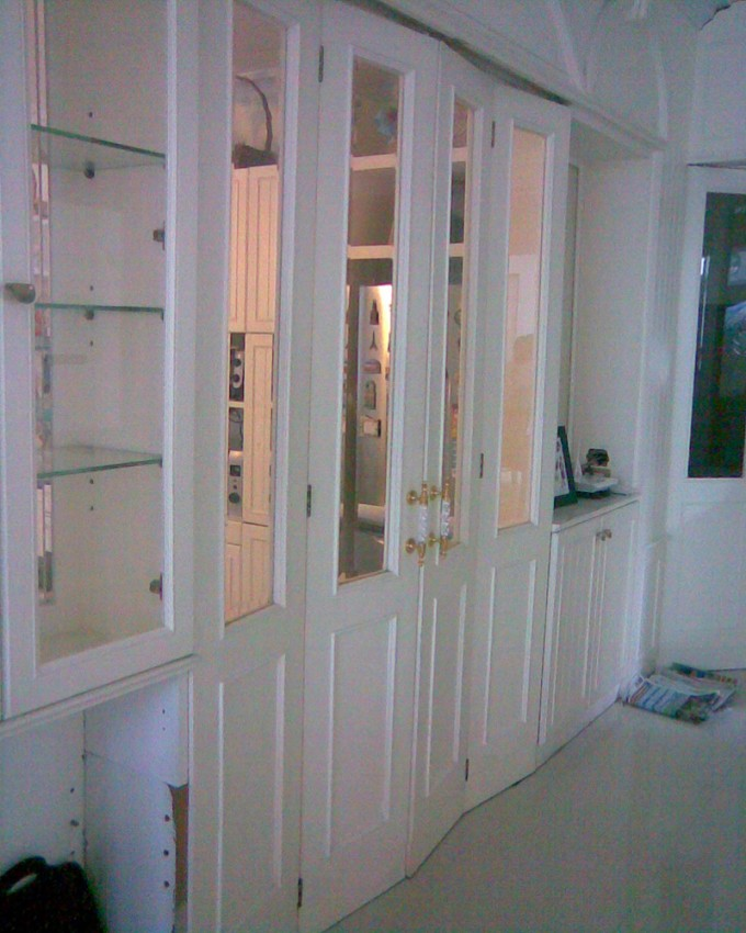 Brilliant White Folding Closet Doors With Shelves And Mirror