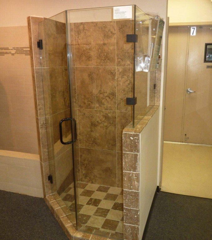 Bronze Frameless Shower Doors With Black Handle Matched With Tan Wall