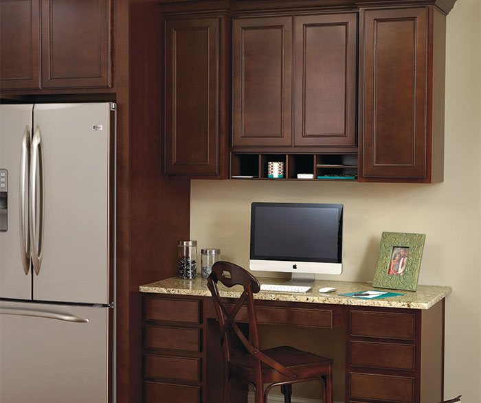 Brown Aristokraft Cabinets With Desk And Frige For Workspace Ideas