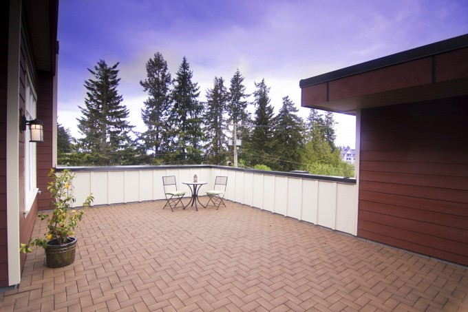Brown Azek Pavers Matched With White Railing Plus Chairs And Table For Patio Ideas