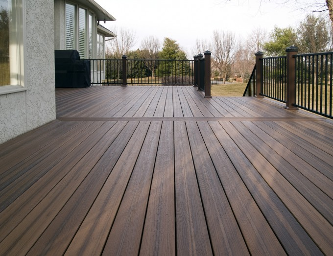 Brown Evergrain Decking Matched With Black Railing And White Wall Ideas