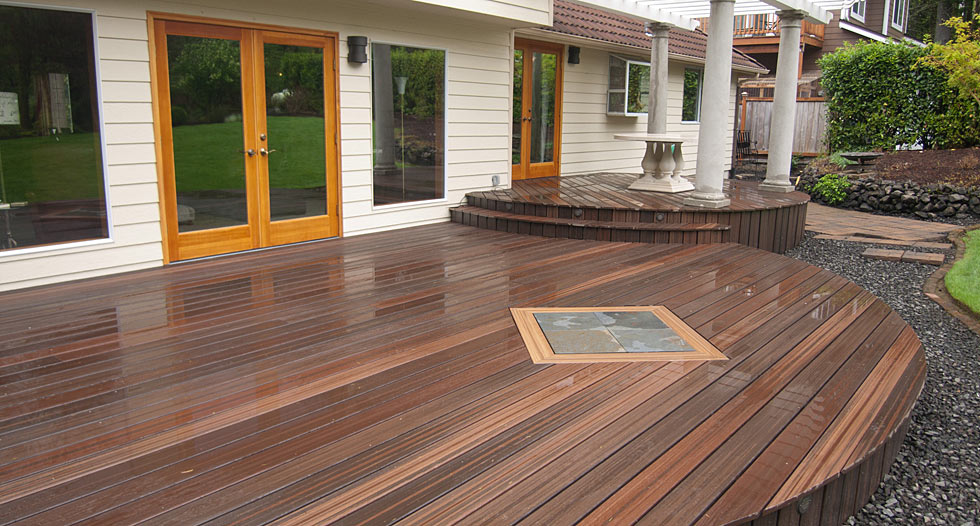 brown evergrain decking matched with white wall plus white pillar for patio ideas