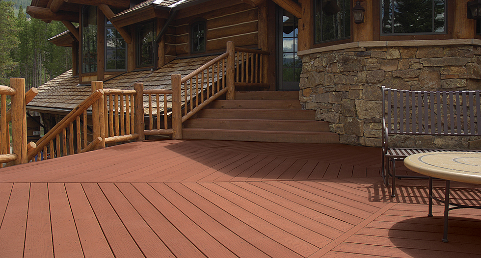 brown evergrain decking matched with wooden railing plus metal chair for patio ideas